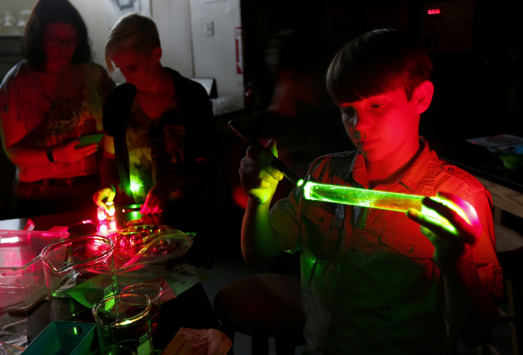 Nicholas Hansen watches as a green light from a laser passes through a glass cylinder at the Cade Museum on Thursday, Sept. 24, 2015 in Gainesville, Fla. The museum will Matt Stamey/Staff photographer