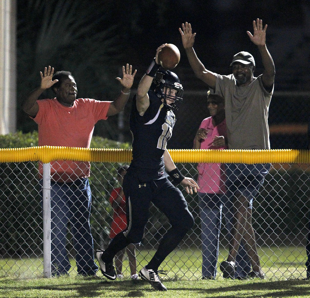 Buchholz Bobcats receiver Luke Whittemore celebrates after catching the game-tying touchdown with less than a minute remaining in the game against the Vanguard Knights on Friday, Sept. 25, 2015 in Gainesville, Fla. The extra point by Buchholz put them ahead by one. The bobcats held on to win 33-32. Matt Stamey/Staff photographer
