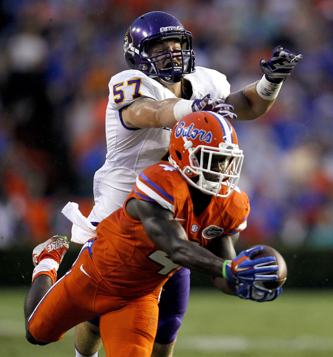 Florida Gators wide receiver Brandon Powell (4) makes a diving catch in front of of East Carolina Pirates linebacker Joe Allely (57) during the first half at Ben Hill Griffin Stadium on Saturday, Sept. 12, 2015 in Gainesville, Fla. (Matt Stamey/Staff photographer)