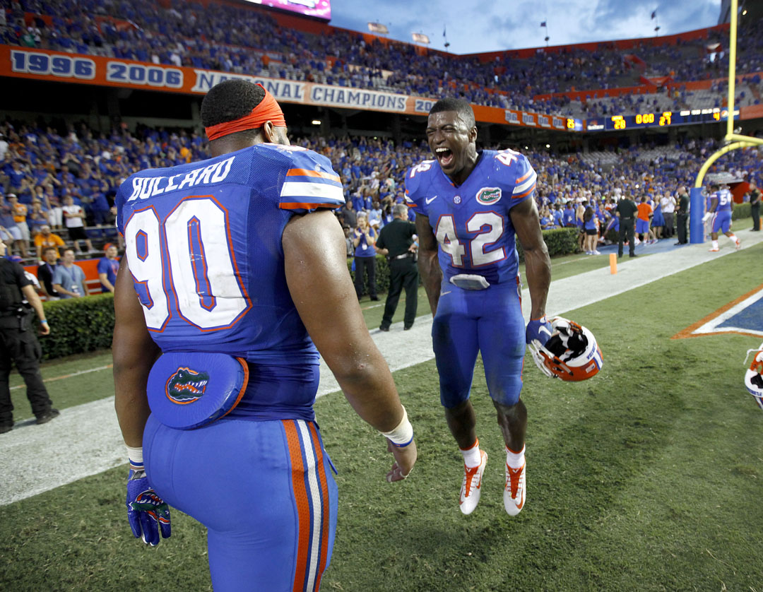Florida Gators defensive lineman Jonathan Bullard (90) and defensive back Keanu Neal (42) celebrate after the game against the Tennessee Volunteers on Saturday, Sept. 26, 2015 in Gainesville, Fla. Florida defeated Tennessee 28-27. Matt Stamey/Staff photographer