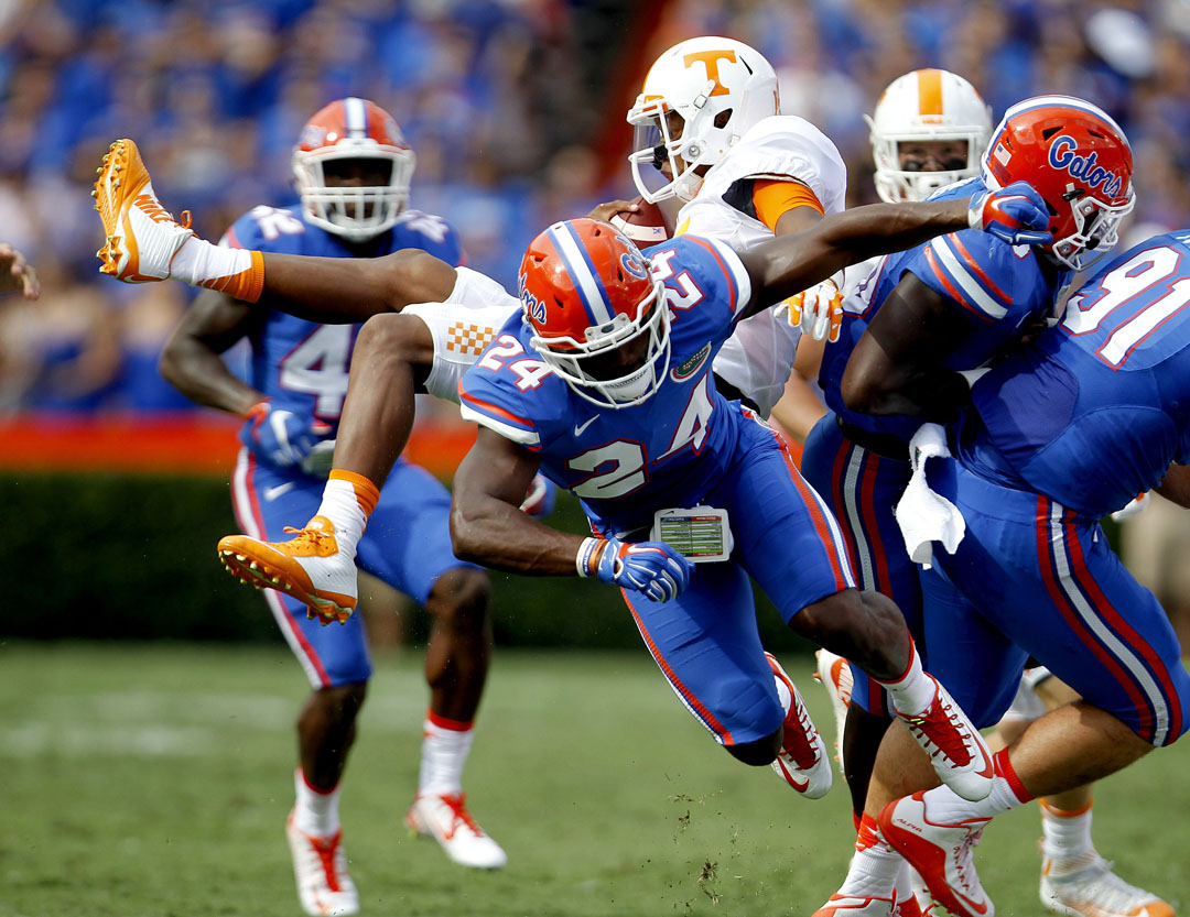 Florida Gators defensive back Brian Poole (24) tackles Tennessee Volunteers quarterback Joshua Dobbs (11) during the first half on Saturday, Sept. 26, 2015 in Gainesville, Fla. Matt Stamey/Staff photographer