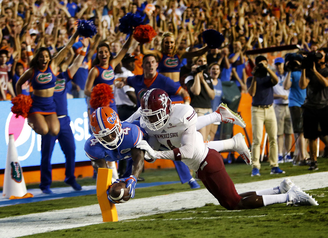 Florida Gators wide receiver Brandon Powell (4) dives for a touchdown past New Mexico State Aggies defensive back Winston Rose (4) during the first half on Saturday, Sept. 5, 2015 in Gainesville, Fla. (Matt Stamey/Staff photographer)