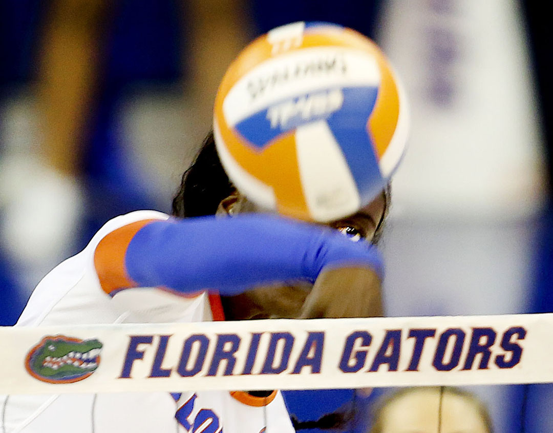 Florida Gators middle blocker Simone Antwi hits the ball against the St. John's Red Storm on Thursday, Sept. 16, 2015 in Gainesville, Fla. Florida defeated St. John's 3-0. Matt Stamey/Staff photographer