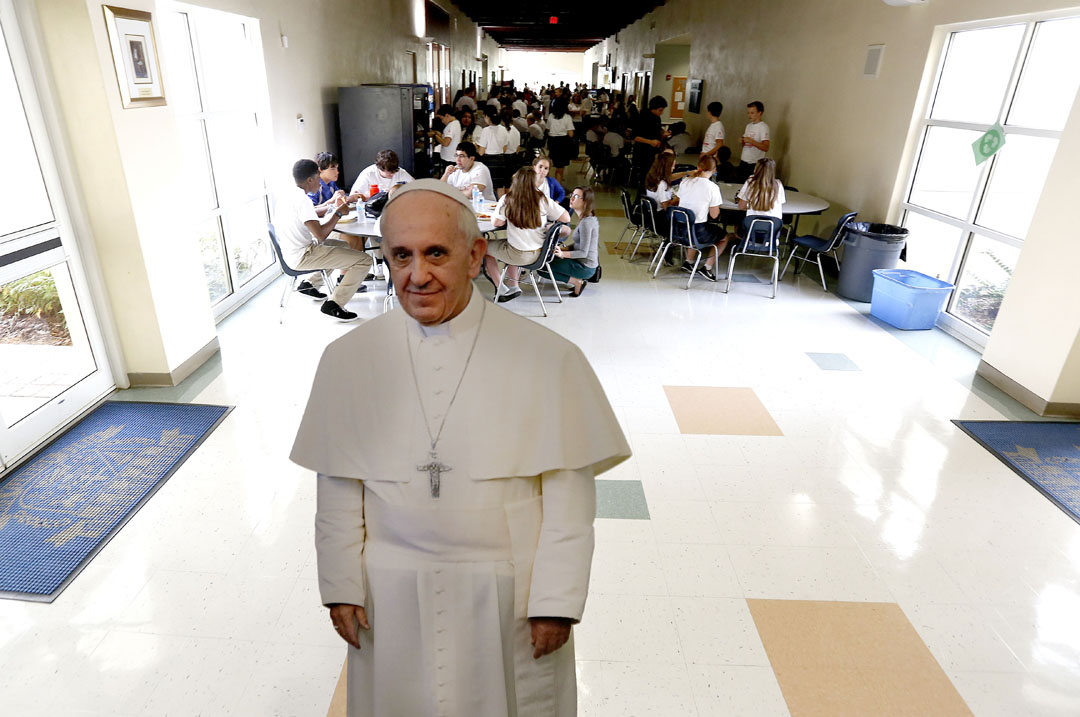 A cardboard cutout of Pope Francis in the hallway as students eat lunch after Mass at St. Francis Catholic High on Tuesday, Sept. 22, 2015 in Gainesville, Fla. The school hosted students from area Catholic schools for a Mass and lunch to celebrate the arrival of Pope Francis to the United States. (Matt Stamey/Staff photographer)