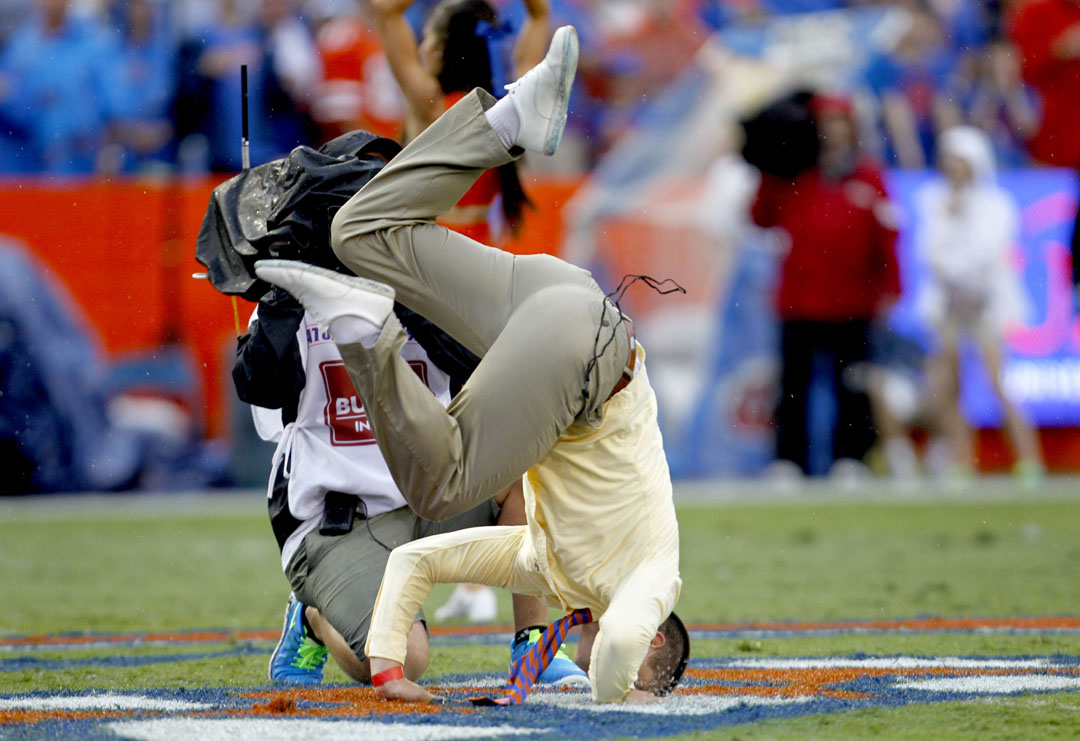 Michael Cizek, honorary Mr. Two Bits, does a back flip before the game against the East Carolina Pirates at Ben Hill Griffin Stadium on Saturday, Sept. 12, 2015 in Gainesville, Fla. Florida defeated the East Carolina Pirates 31-24. (Matt Stamey/Staff photographer)