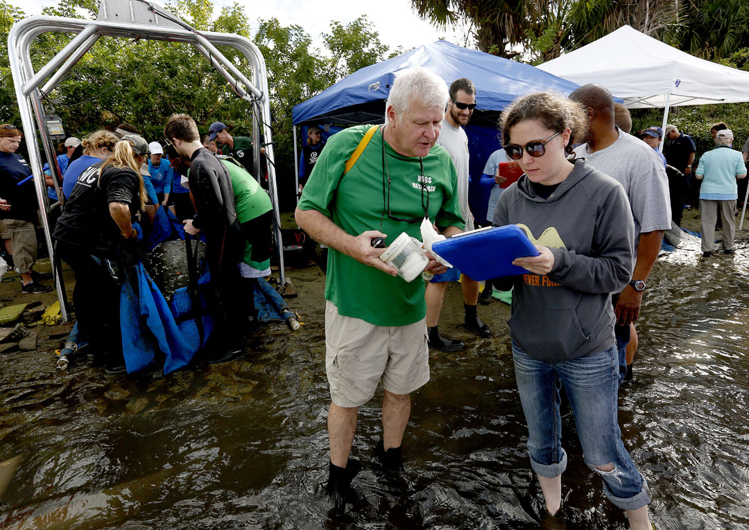 Dr. Robert Bonde, research biologist with the U.S. Geological Survey, helps record data during the USGS manatee captures and health assessments on Wednesday, Dec. 9, 2015 in Crystal River, FL. A team of scientists, veterinarians and volunteers spent two days capturing manatees to gather health data. This was the 10th year of the assessments. The program monitors the status of the regional population of Florida manatees. Matt Stamey/Staff photographer