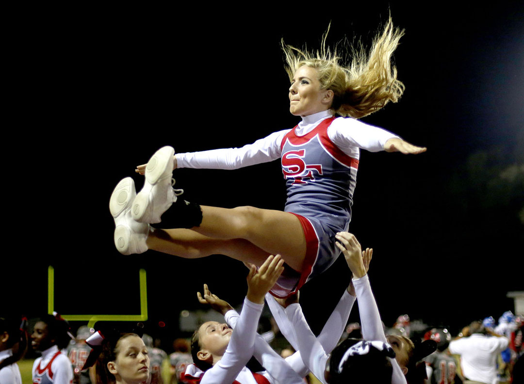 Santa Fe Raiders cheerleaders perform against the Keystone Heights Indians on Friday, Oct. 30, 2015 in Alachua, Fla. Santa Fe defeated Keystone heights 42-0 to clinch the division championship. Matt Stamey/Staff photographer
