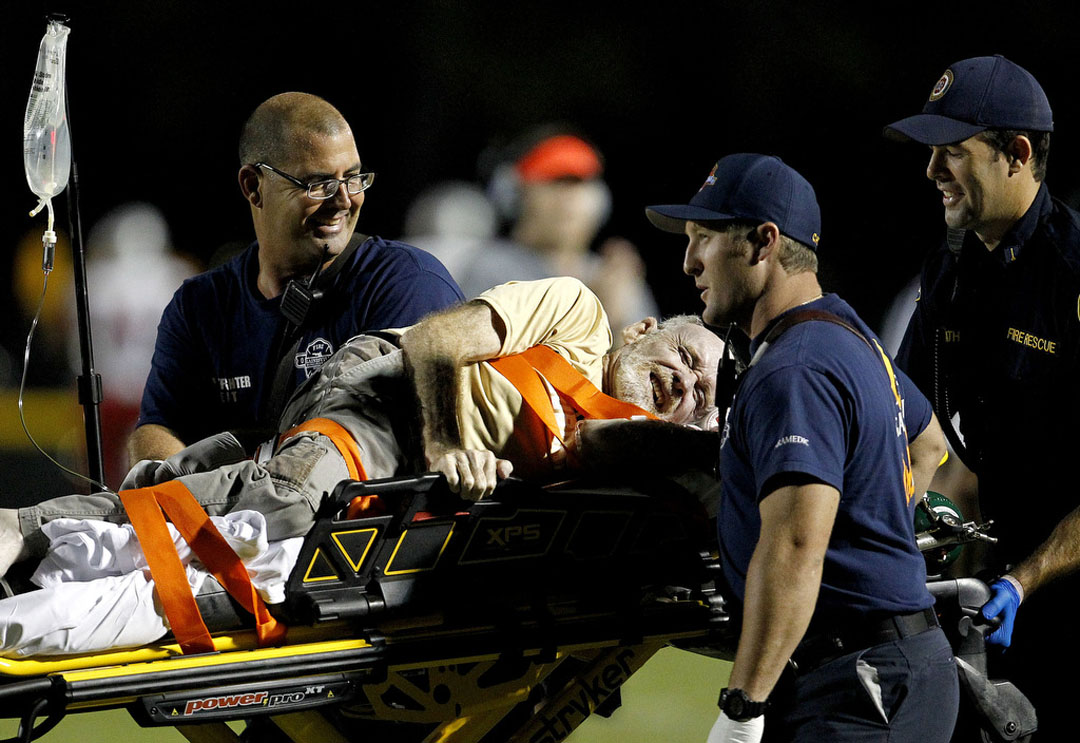 The grandfather of Buchholz Bobcats receiver Bryan Jaszczak laughs after giving a thumbs up to the crowd while being taken to an ambulance after being knocked over on the sidelines during the game against the Vanguard Knights on Friday, Sept. 25, 2015 in Gainesville, Fla. Buchholz defeated Vanguard 33-32. Matt Stamey/Staff photographer