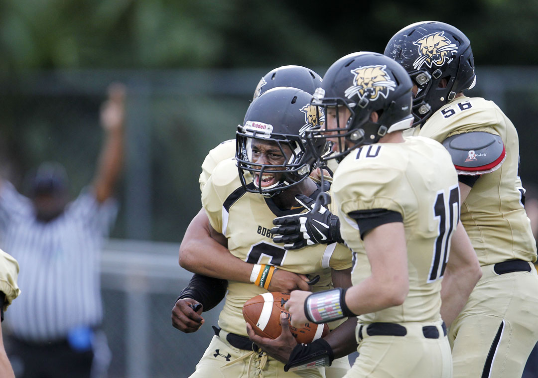 Buchholz Bobcats running back Torrey Richardson (6) celebrates with teammates after scoring a touchdown in the first quarter against the Eastside Rams during the first game of the season on Friday, August 28, 2015 in Gainesville, Fla. Buchholz defeated Eastside 48-13. (Matt Stamey/Staff photographer)