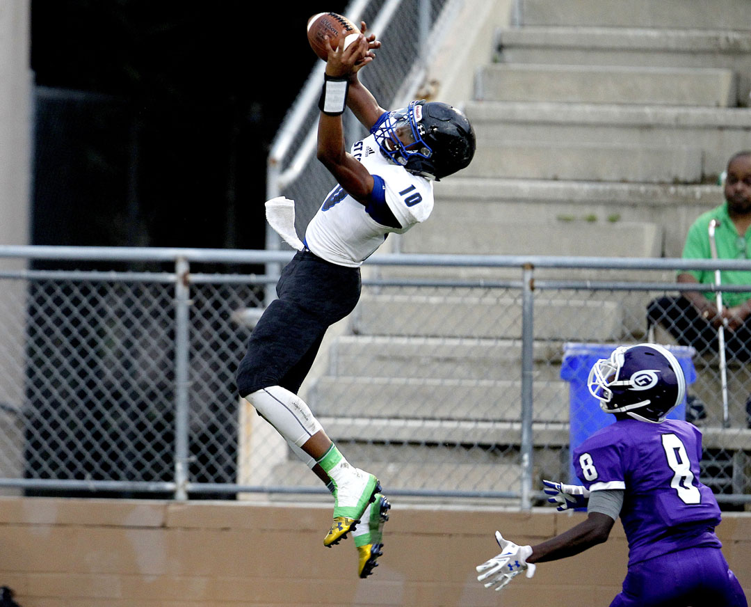 First Coast Buccaneers receiver Kevin Stepherson makes a catch over Gainesville Hurricanes defender RaiJuahn Alexander on Friday, Sept. 4, 2015 in Gainesville, Fla. Gainesville defeated First Coast 31-26. Matt Stamey/Staff photographer