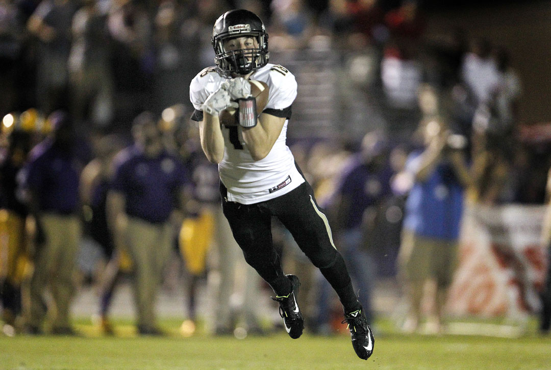 Buchholz Bobcats receiver Bryan Jaszczak makes a diving catch against the Columbia Tigers on Friday, Sept. 11, 2015 in Gainesville, Fla. Columbia defeated Buchholz 39-27. (Matt Stamey/Staff photographer)