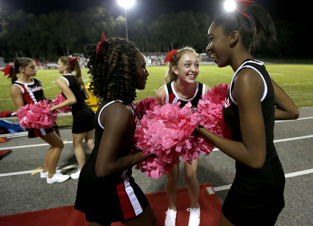 Santa Fe Raiders cheerleaders perform after the first quarter against the Bradford Tornados on Friday, Oct. 2, 2015 in Alachua, Fla. Matt Stamey/Staff photographer