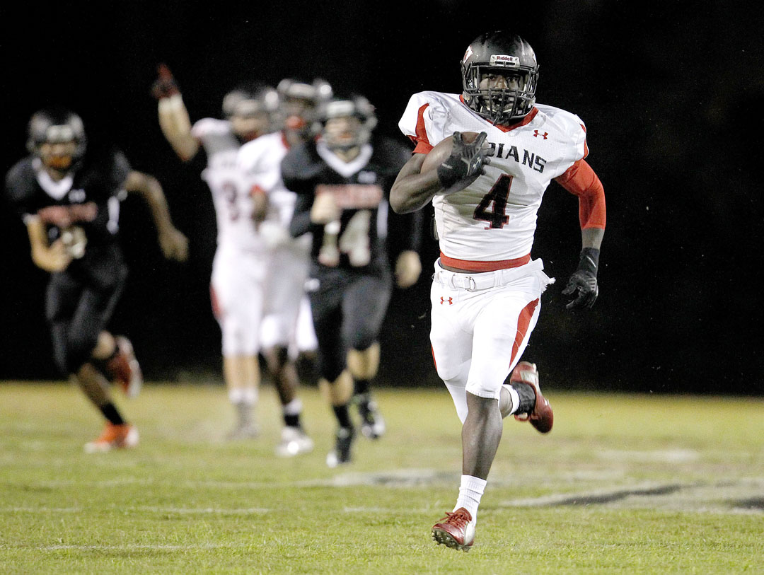 Fort White Indians running back Donald Robinson returns the opening kickoff for a touchdown against the Hawthorne Hornets on Thursday, Oct. 29, 2015 in Hawthorne, Fla. Ft. White defeated Hawthorne 40-18. Matt Stamey/Staff photographer