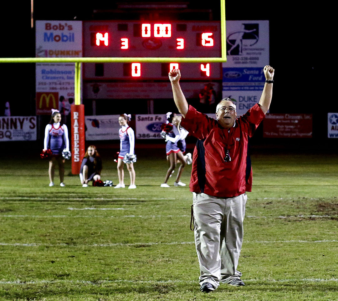 Santa Fe Raiders head coach Bill Wiles celebrates after the class 4A region 2 finals against the Dunnellon Tigers on Friday, Nov. 20 2015 in Alachua, Fla. Santa Fe defeated Dunnellon 15-14. Matt Stamey/Staff photographer Gainesville Magazine