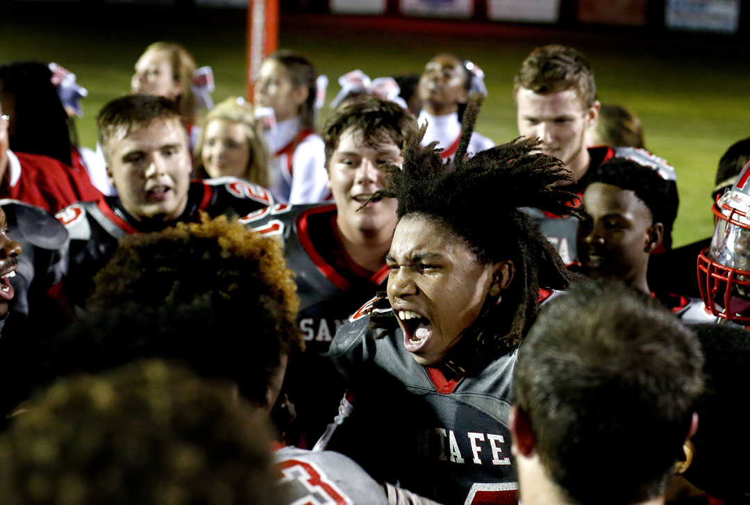 Santa Fe Raiders players celebrate after the class 4A region 2 finals against the Dunnellon Tigers on Friday, Nov. 20 2015 in Alachua, Fla. Santa Fe defeated Dunnellon 15-14. Matt Stamey/Staff photographer Gainesville Magazine