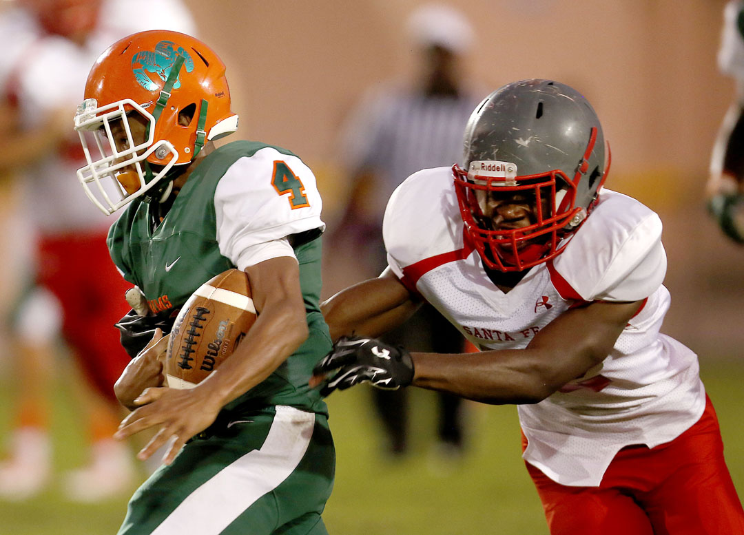 Eastside Rams wide receiver Devonte Tanksley has the ball knocked away by a Santa Fe Raiders defender on Friday, Sept. 9, 2016 in Gainesville, FL. The Raiders recovered the fumble. Santa Fe defeated Eastside 24-20. Matt Stamey/Gainesville Sun