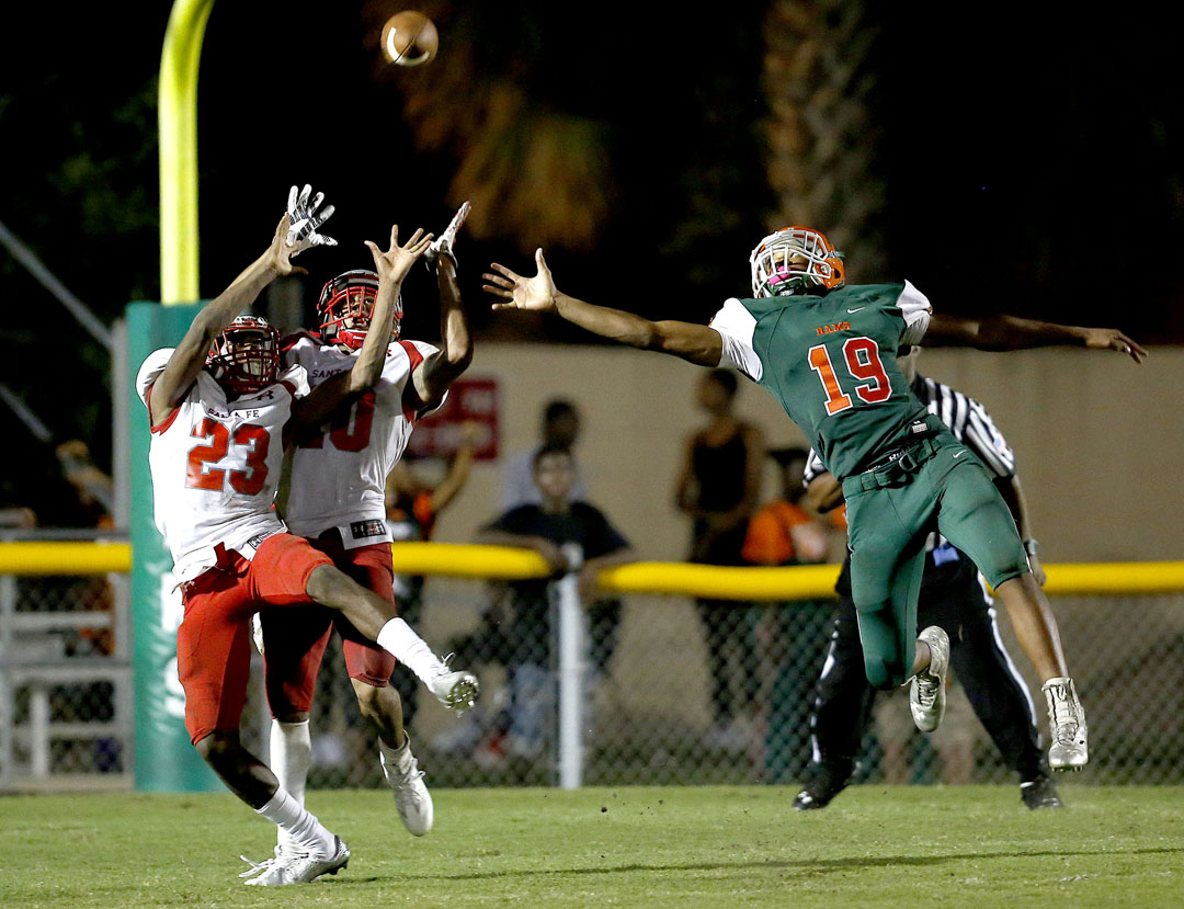 Santa Fe Raiders safety Isaiah Cromarty (10) intercepts a pass intended for Eastside Rams receiver Anthony Richardson on Friday, Sept. 9, 2016 in Gainesville, FL. Santa Fe defeated Eastside 24-20. Matt Stamey/Gainesville Sun