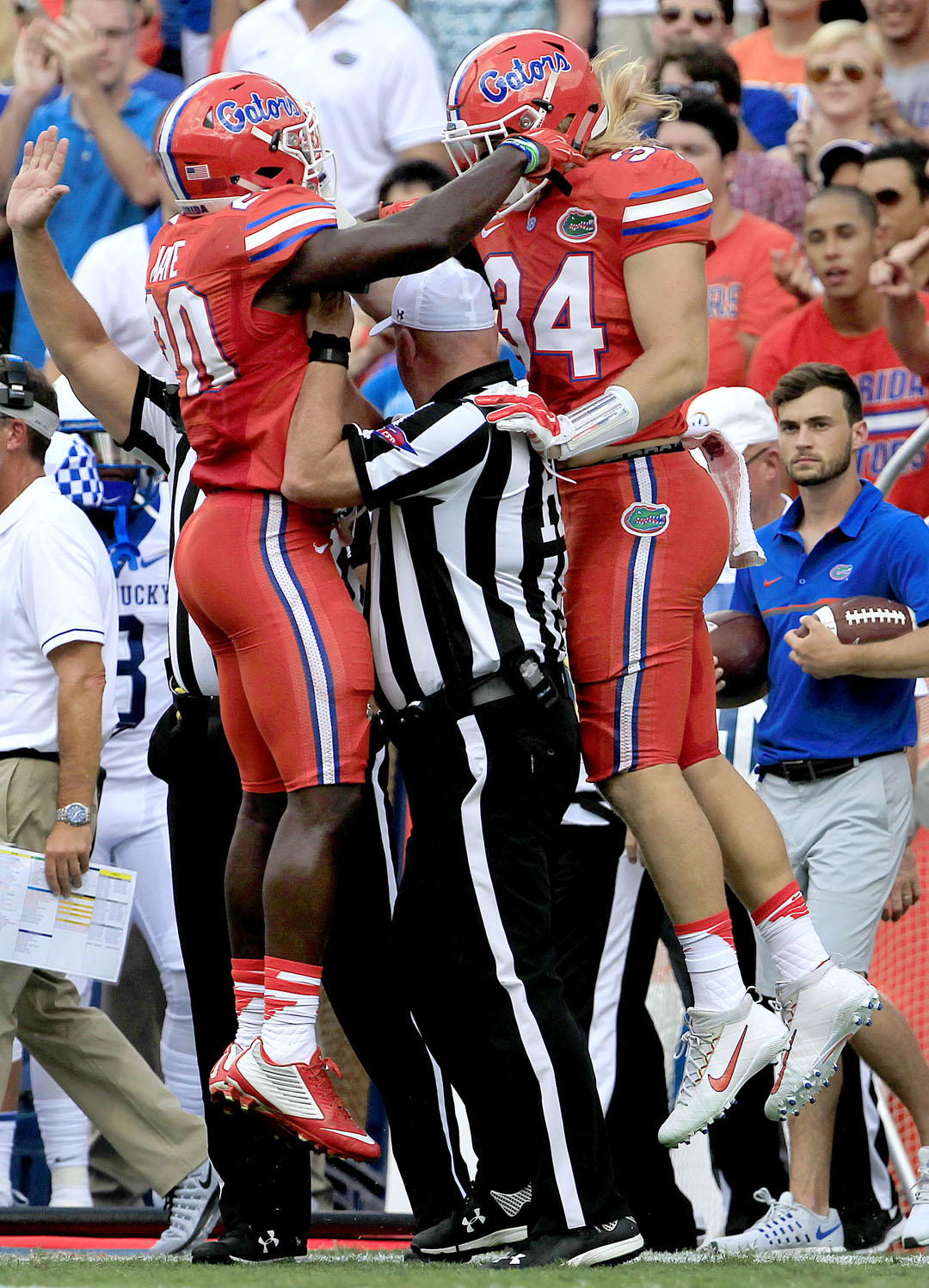Florida Gators defensive back Marcus Maye (20) and linebacker Alex Anzalone (34) celebrate around a referee against the Kentucky Wildcats during the first half at Steve Spurrier Florida Field at Ben Hill Griffin Stadium on Saturday, Sept. 10, 2016 in Gainesville, FL. Florida defeated Kentucky 45-7. Matt Stamey/Gainesville Sun