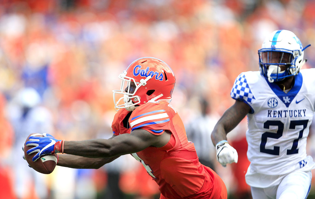 Florida Gators wide receiver Brandon Powell (4) hauls in a pass in front of Kentucky Wildcats safety Mike Edwards (27) during the first half at Steve Spurrier Florida Field at Ben Hill Griffin Stadium on Saturday, Sept. 10, 2016 in Gainesville, FL. After review, it was determined that the ball hit the ground as he fell and was ruled incomplete. Florida defeated Kentucky 45-7. Matt Stamey/Gainesville Sun