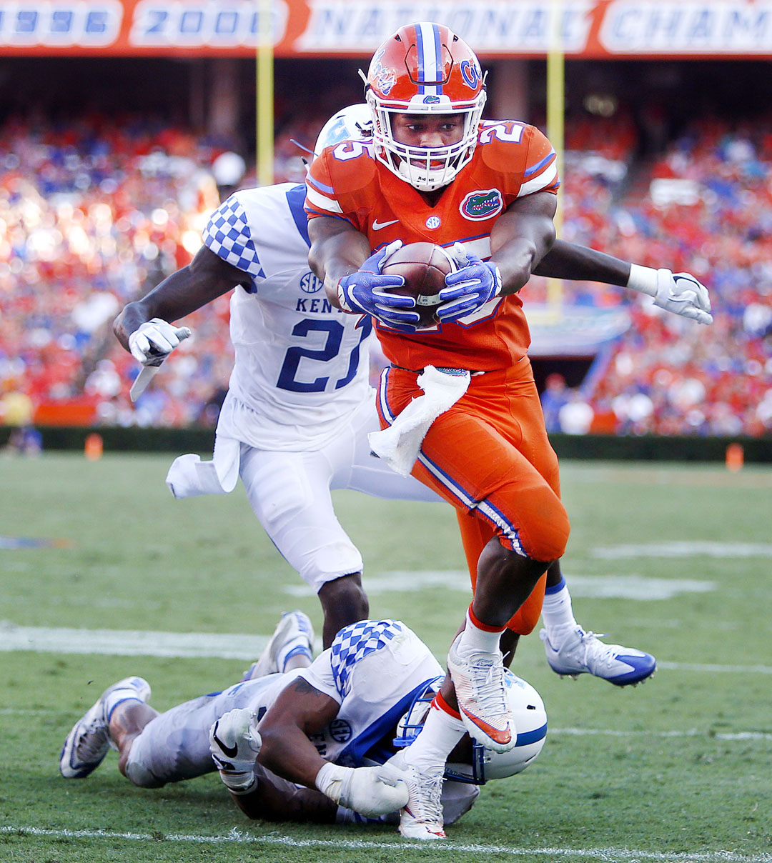 Florida Gators running back Jordan Scarlett (25) runs in for a touchdown against the Kentucky Wildcats during the second half at Steve Spurrier Florida Field at Ben Hill Griffin Stadium on Saturday, Sept. 10, 2016 in Gainesville, FL. Florida defeated Kentucky 45-7. Matt Stamey/Gainesville Sun