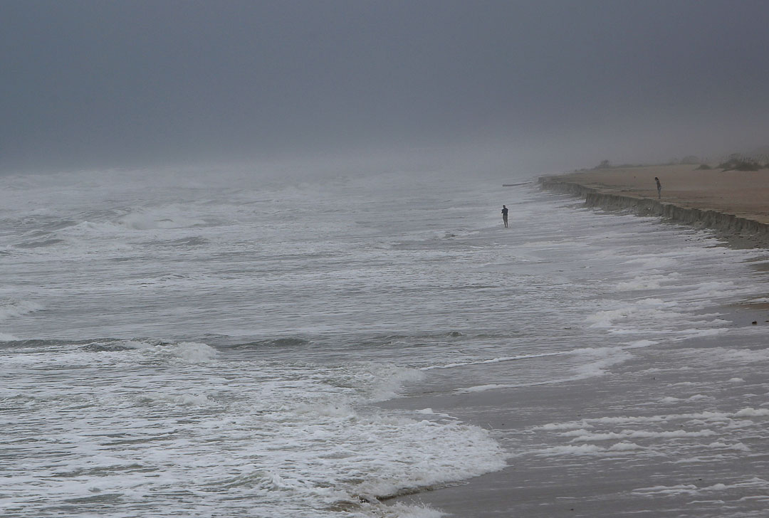 A mans stands in the surf as Hurricane Matthew approaches on Thursday, Oct. 6, 2016 in St. Augustine, FL. Matt Stamey/Gainesville Sun