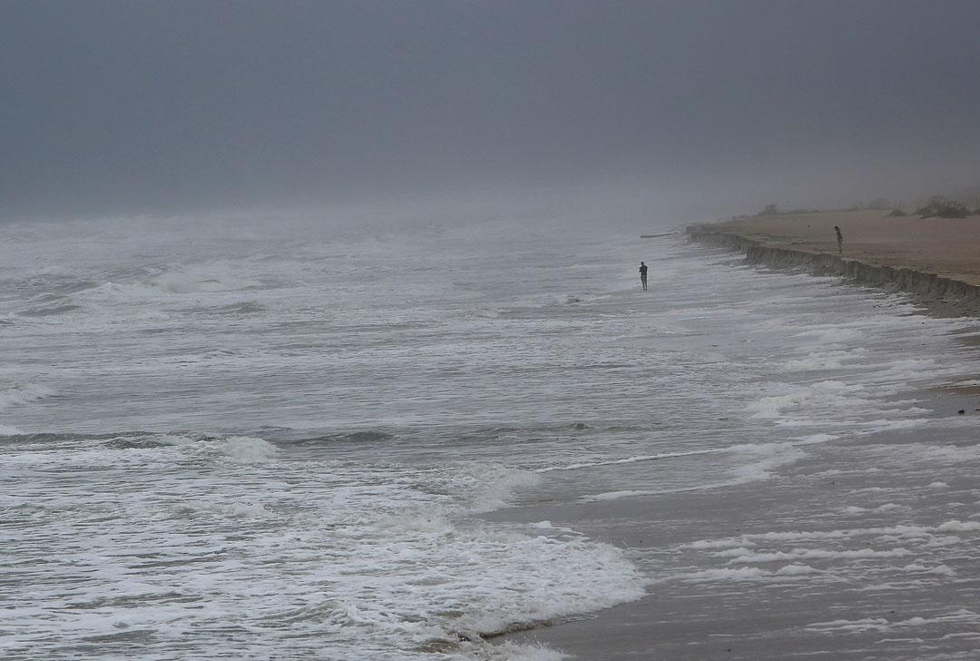 A mans stands in the surf as Hurricane Matthew approaches on Thursday, Oct. 6, 2016 in St. Augustine, FL. Matt Stamey/Gainesville Sun