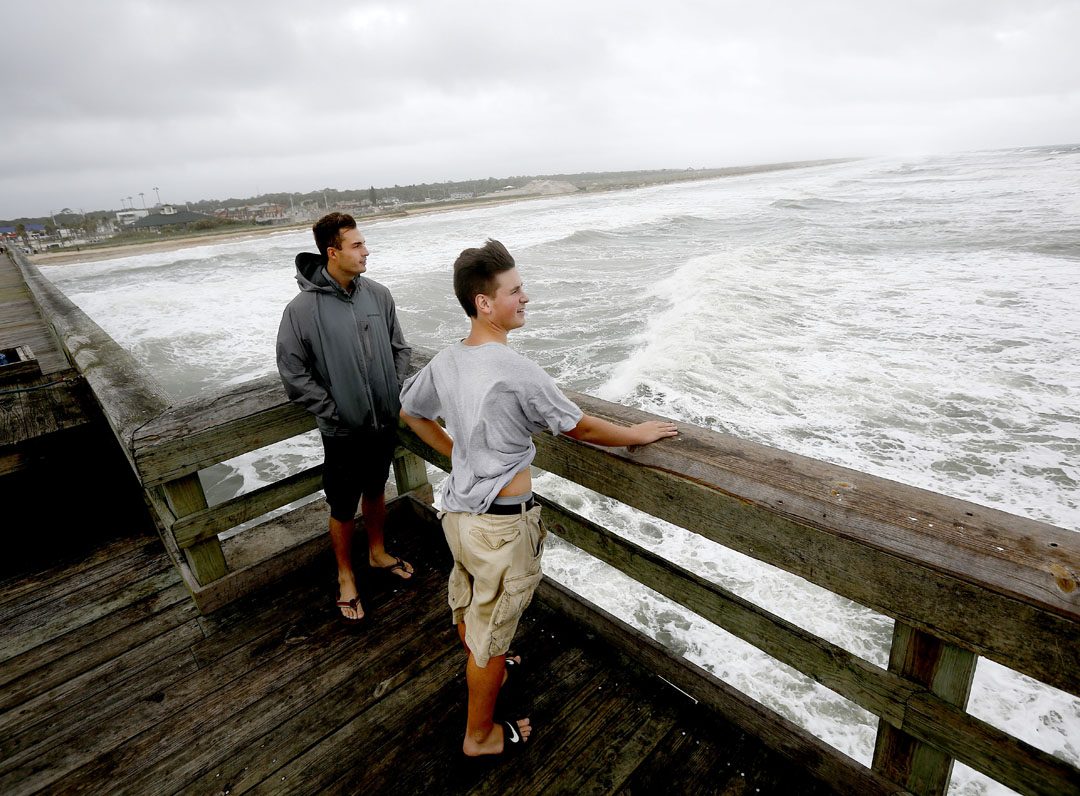 Flagler College students Corey Wademan, left, and Joe Mostler stand at the end of the pier to watch the waves as Hurricane Matthew approaches on Thursday, Oct. 6, 2016 in St. Augustine, FL. Matt Stamey/Gainesville Sun