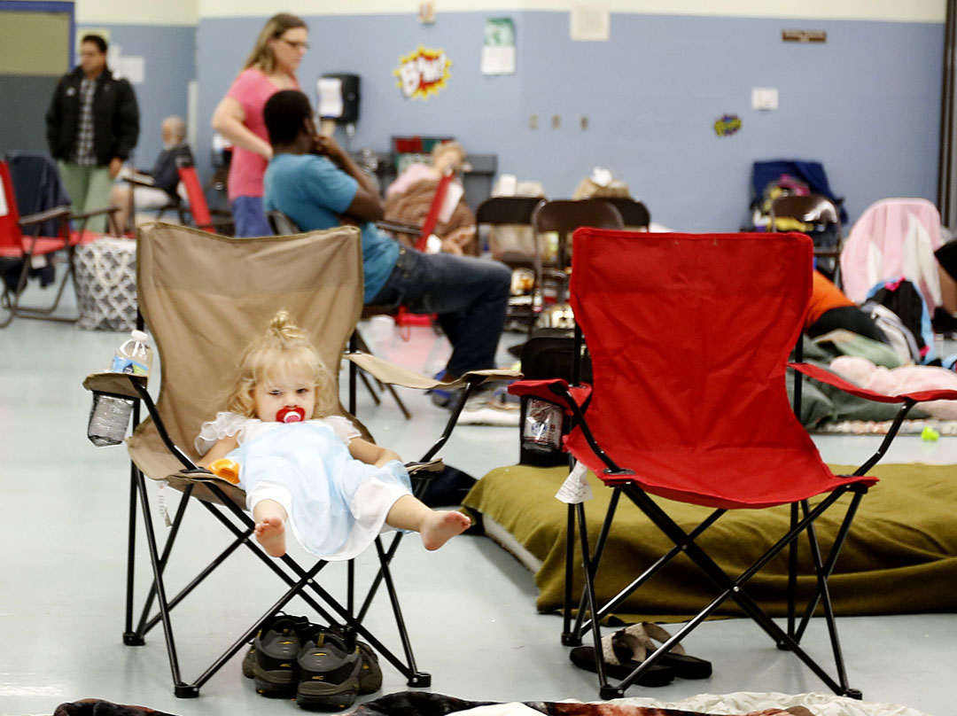June Meeker, 2, sits in a chair after evacuating to Mason Elementary as Hurricane Matthew approaches on Thursday, Oct. 6, 2016 in St. Augustine, FL. The school's cafeteria doubled as a storm shelter. Matt Stamey/Gainesville Sun
