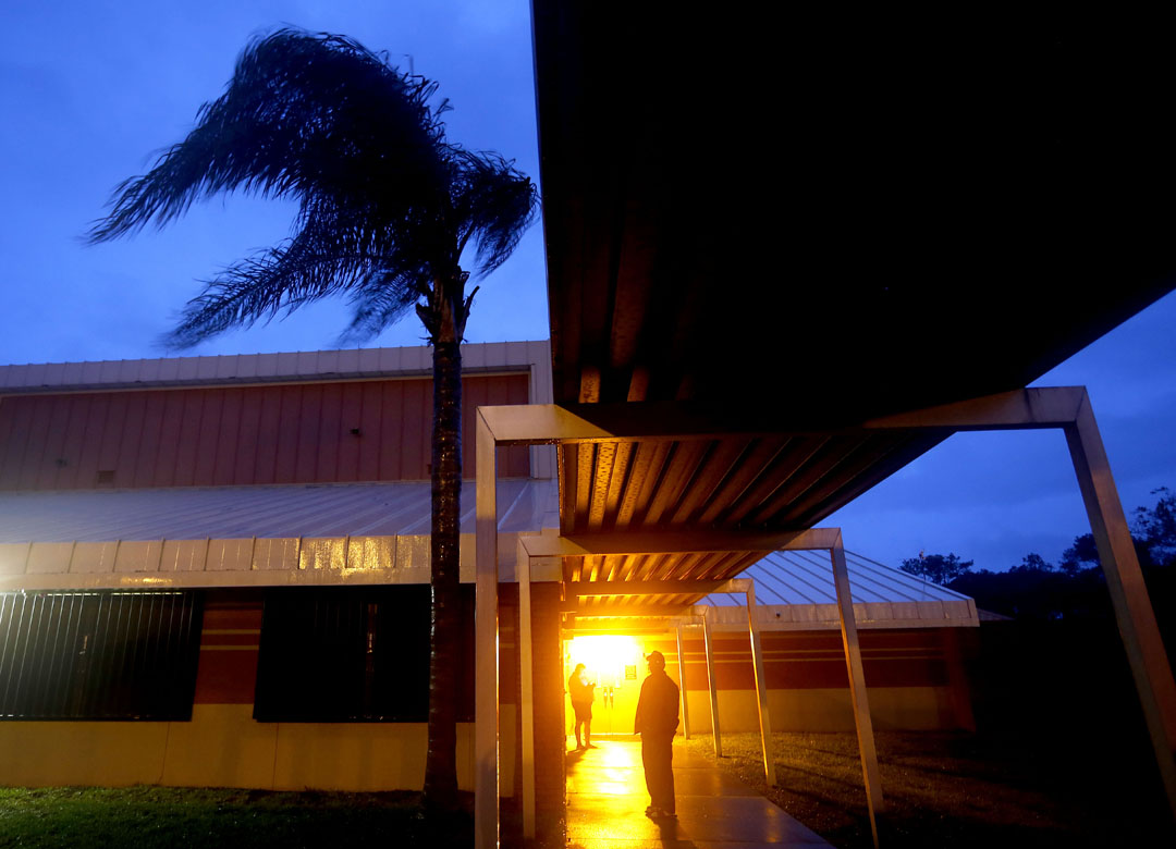 Evacuees step outside to watch the wind and rain while at the shelter at Mason Elementary during Hurricane Matthew on Friday Oct. 7, 2016 in St. Augustine, FL. Matt Stamey/Gainesville Sun