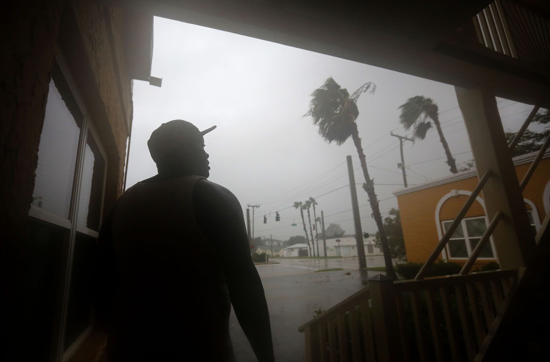 A man who identified himself as J.J. watches the wind and rain from the front door of his apartment during Hurricane Matthew on Thursday, Oct. 6, 2016 in St. Augustine, FL. Matt Stamey/Gainesville Sun