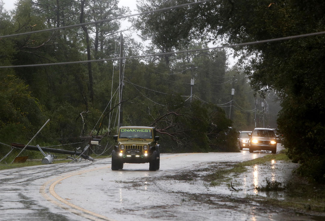 Traffic navigates around down power lines during Hurricane Matthew on Thursday, Oct. 6, 2016 in St. Augustine, FL. Matt Stamey/Gainesville Sun