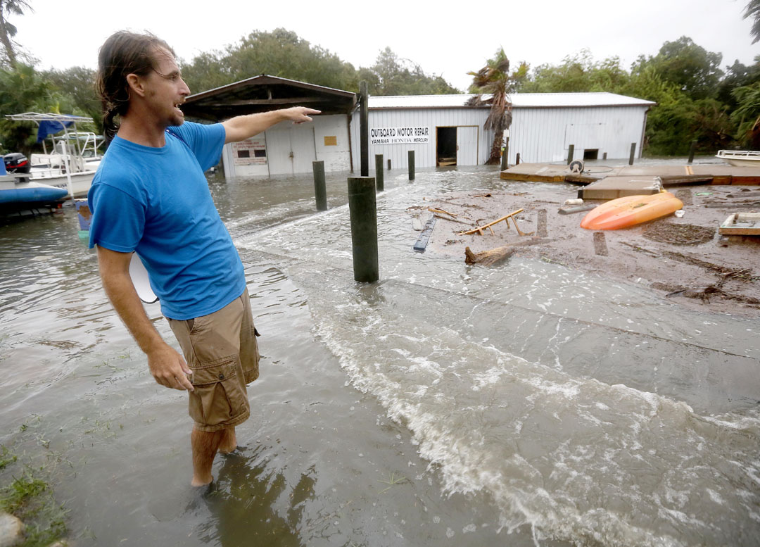 Adam Murley points out flooding and damage at a fishing camp along the intracoastal at Crescent Beach during Hurricane Matthew on Thursday, Oct. 6, 2016 in St. Augustine, FL. Matt Stamey/Gainesville Sun