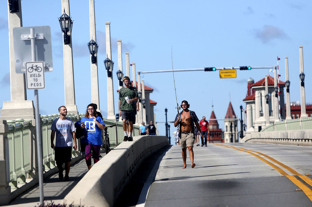Pedestrians walk across the Bridge of Lions after Hurricane Matthew on Friday, Oct. 8, 2016 in St. Augustine, FL. Vehicles were not allowed and only residents could walk across. Matt Stamey/Gainesville Sun