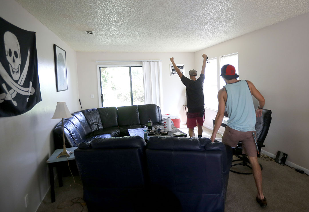 Chase Perkins throws his fists in the air with excitement after seeing that his house on the island didn't take on any water from Hurricane Matthew on Friday, Oct. 8, 2016 in St. Augustine, FL. Matt Stamey/Gainesville Sun