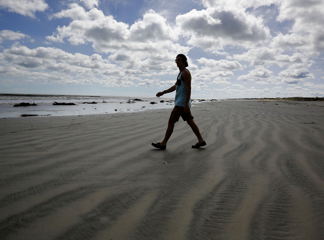 Garrett Croyle walks along Crescent beach after Hurricane Matthew on Friday, Oct. 8, 2016 in St. Augustine, FL. Matt Stamey/Gainesville Sun