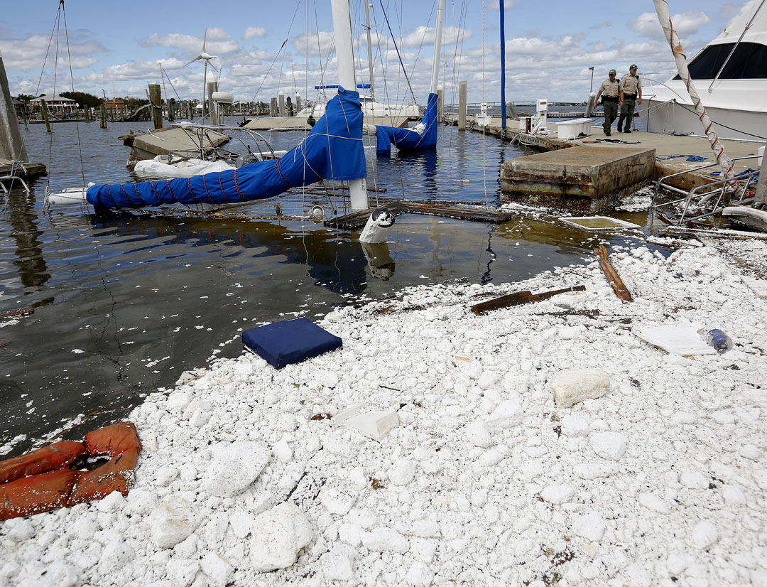Florida Fish and Wildlife officials walk past two sunken boats at the Conch Marina after Hurricane Matthew on Friday, Oct. 8, 2016 in St. Augustine, FL. Matt Stamey/Gainesville Sun