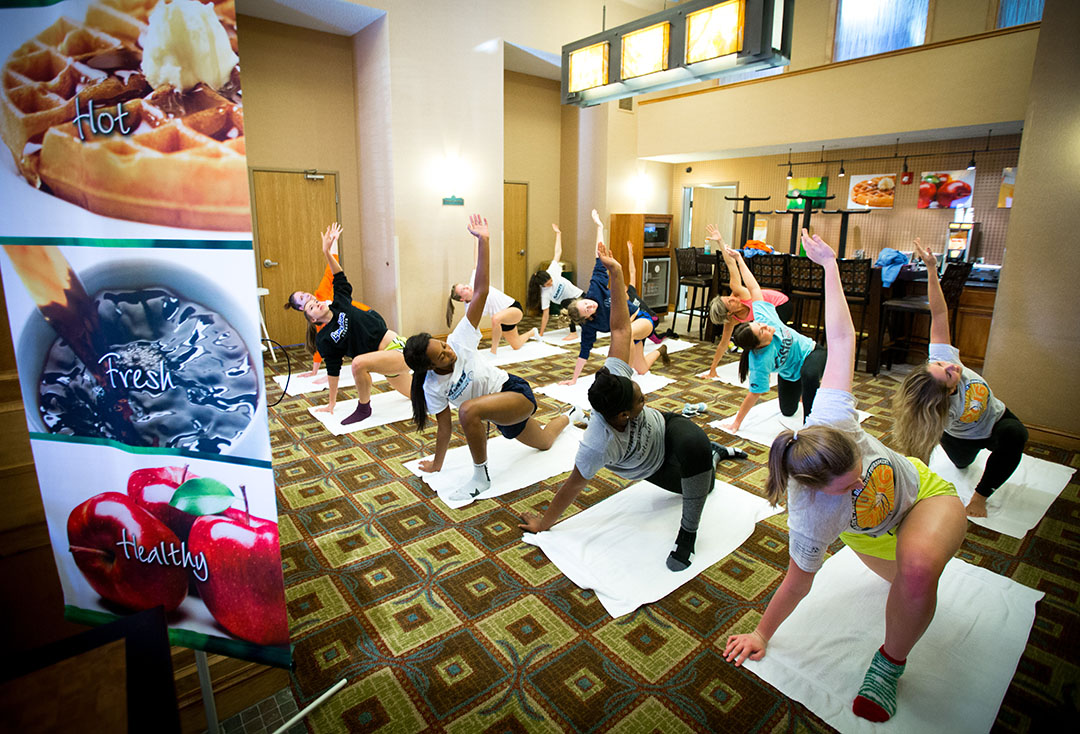 The Santa Fe Saints do a yoga workout in the lobby of their hotel before their final four match at the NJCAA National Tournament on Friday, Nov. 18, 2016 in in Casper, WY. (Photo by Matt Stamey/Santa Fe College)