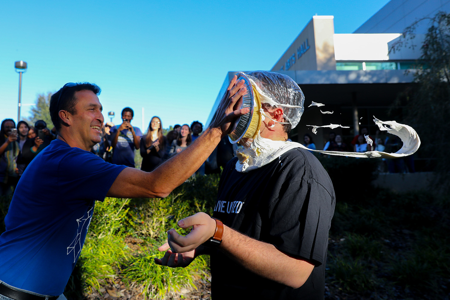 After losing the penny wars, Santa Fe College Student Body President Cale McCall received a pie in the on Friday, Nov. 17, 2017 in Gainesville, Fla. The SF faculty and staff defeated the students in the Penny Wars 2017 competition, awarding Vice President of Student Affairs Dr. Naima Brown the right to hit McCall with a pie. Dr. Brown decided not to hit McCall with the pie, instead giving the honor to Doug Bagby Associate Director of Student Life. Penny wars is a fundraising effort at Santa Fe College for the United Way of North Central Florida. (Photo by Matt Stamey/Santa Fe College) ***SUbjects have Releases***