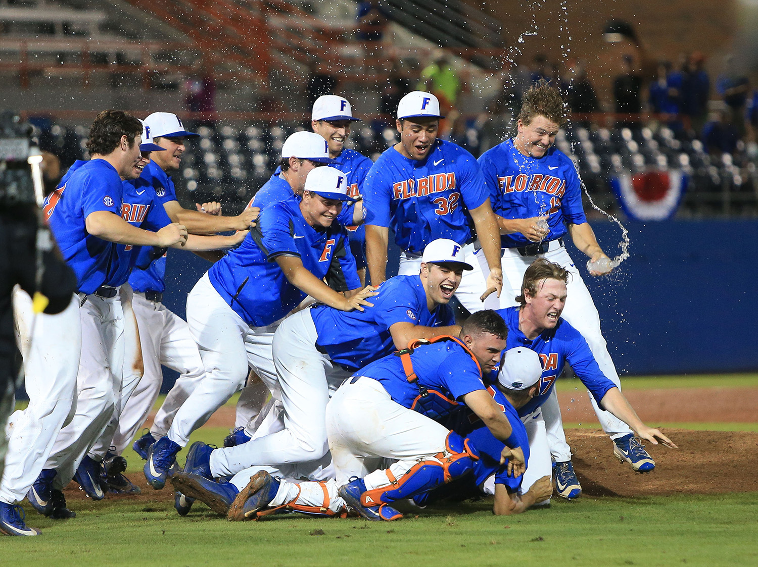 Florida players celebrate after defeating Wake Forest 3-0 in an NCAA college super regional baseball game Monday, June 12, 2017, in Gainesville, Fla. (AP Photo/Matt Stamey)