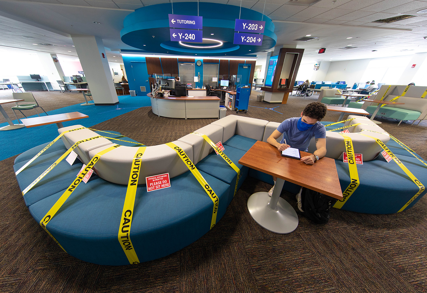 A student studies at the one area of the couch allowed due to social distancing guidelines in the library during the second day of classes at Santa Fe College on Aug. 25, 2020 (Matt Stamey/Santa Fe College ) ***Subjects Have Releases***
