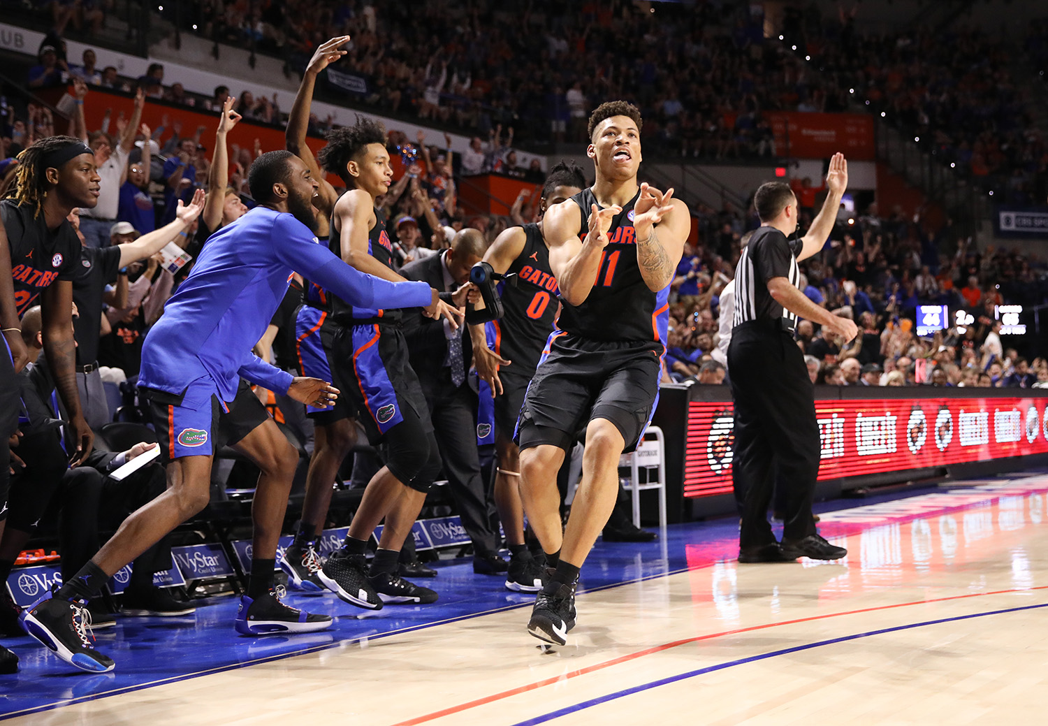 Florida forward Keyontae Johnson (11) celebrates after making a three point shot against Auburn during the second half of an NCAA college basketball game Saturday, Jan. 18, 2020, in Gainesville, Fla. (AP Photo/Matt Stamey)